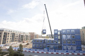 The new Concordia Academy modular school is craned into position by McAvoy